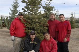 Big M Services Team standing around Christmas Tree