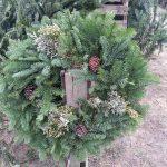 Christmas wreath on fence post